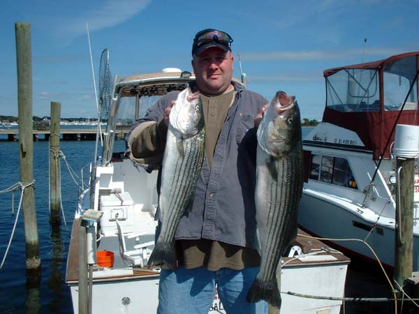 Zig holds two nice bass taken at Block Island
